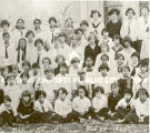 Photo of an Incarnate Word Academy school group.  Photo is in three parts.  Individuals are...